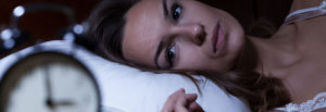 Insomnia header image of young lady laying on pillow
